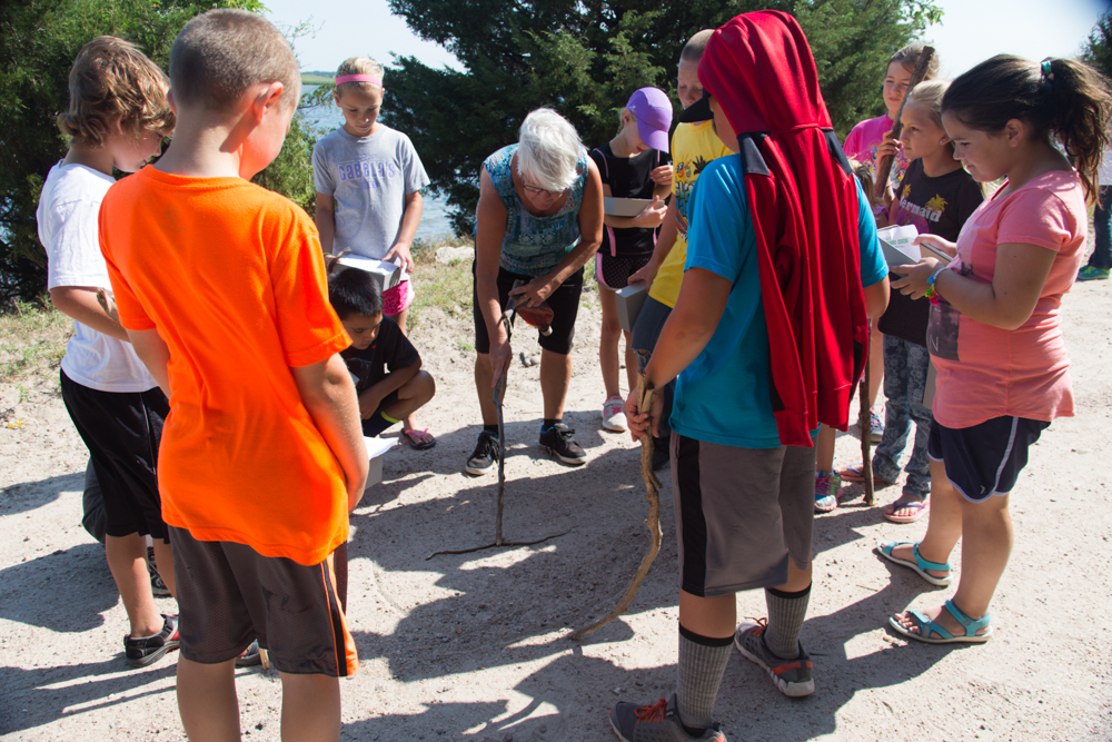 Ogallala Public Schools teacher Nancy Armstrong shows participants in the 2016 Art Adventure Camp a specimen of the local wildlife.